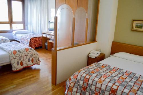 A bed or beds in a room at Pension Payvi