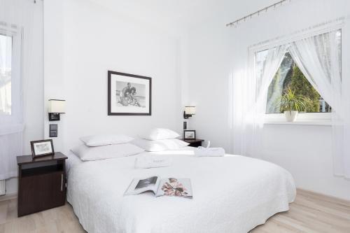 Łóżko lub łóżka w pokoju w obiekcie Zwierzyńscy Residence
