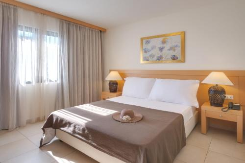 A bed or beds in a room at Ariadne Beach