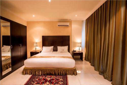 Кровать или кровати в номере Mikhael's Hotel