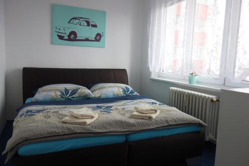 Postel nebo postele na pokoji v ubytování Apartmán Moravská Ostrava