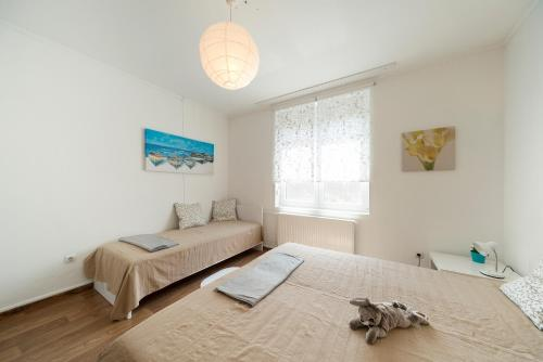 A bed or beds in a room at Eden Garden Apartments