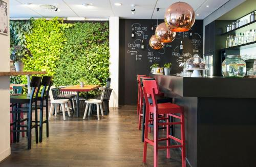 A restaurant or other place to eat at Conscious Hotel Vondelpark