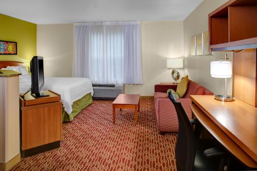 A television and/or entertainment center at MainStay Suites Columbus Worthington