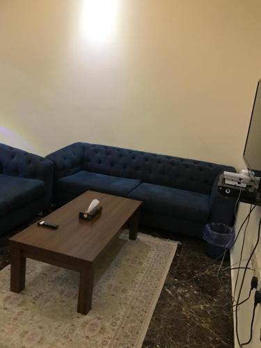 Uma área de estar em Saraya Al daraaya Aparthotel