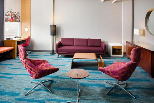 A seating area at Aloft Charlotte City Center