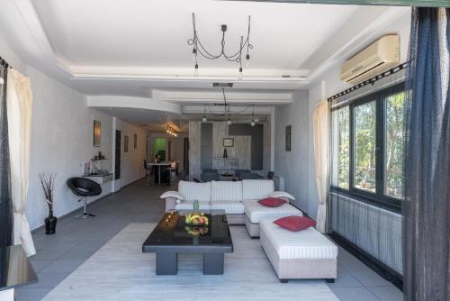 A seating area at Naiades Almiros Beach Villa