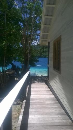 The swimming pool at or close to Evis Resort at Nggatirana Island