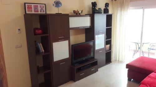 Una televisión o centro de entretenimiento en Apartamento Cristina