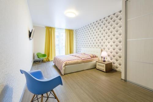 Кровать или кровати в номере Утро в Петербурге