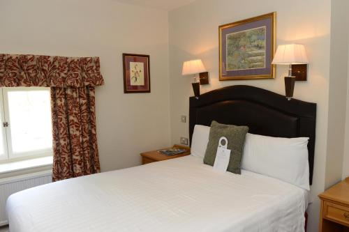 A bed or beds in a room at Hall Garth Hotel; BW Signature Collection