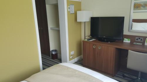 A television and/or entertainment center at Holiday Inn Derby/Nottingham, an IHG Hotel