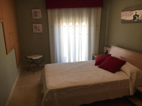 Cama o camas de una habitación en La Casita Blanca