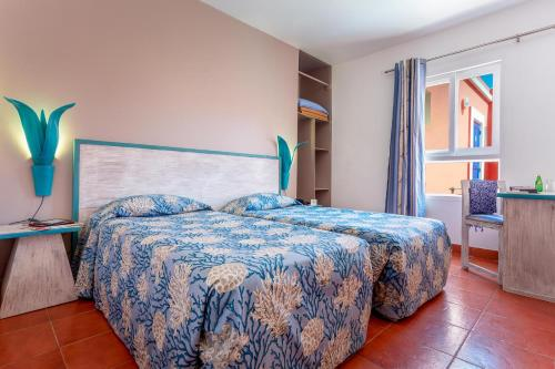 A bed or beds in a room at La Madrague-Surf Beach Sea