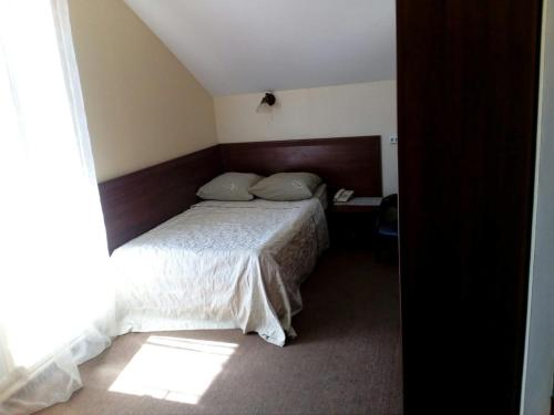Кровать или кровати в номере Гостиница «Русь»