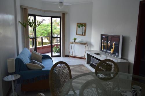 Uma área de estar em Edifício Graceland - Caiobá