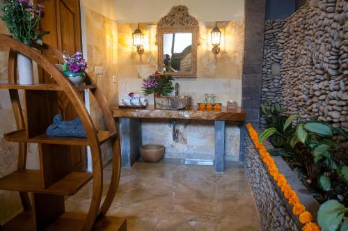 A kitchen or kitchenette at Taman Rahasia Tropical Sanctuary and Spa