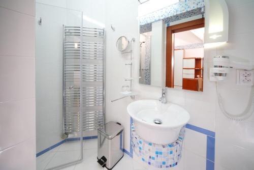 Kúpeľňa v ubytovaní Hotel Enchanté