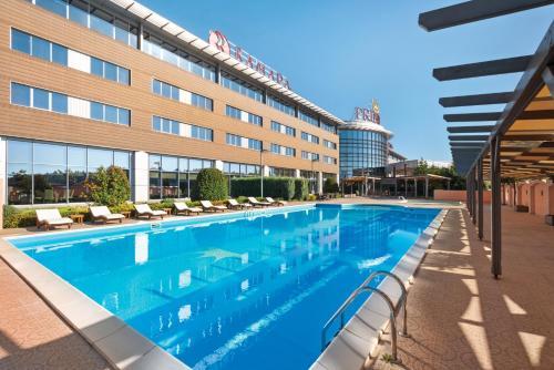 The swimming pool at or near Ramada Plaza by Wyndham Gevgelija