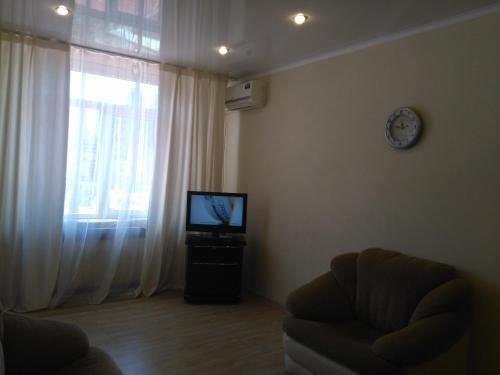 Телевизор и/или развлекательный центр в Апартаменты «ApartmentHouse»
