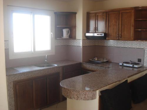 A kitchen or kitchenette at Flathotel