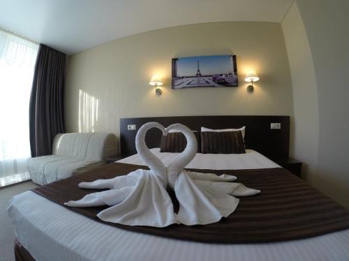 Кровать или кровати в номере Отель Терраса
