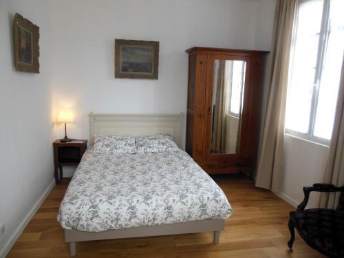 Un ou plusieurs lits dans un hébergement de l'établissement L'Expressoir-Maison d'hôtes