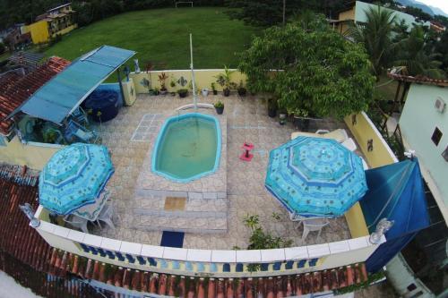 Uma vista da piscina em Pousada Solstício De Verão ou nos arredores