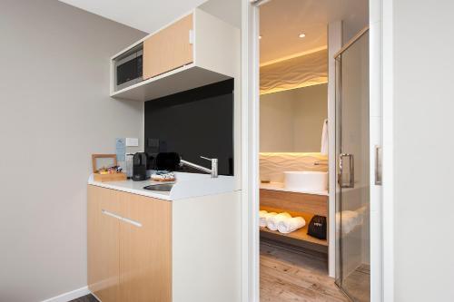 A kitchen or kitchenette at Allure On Ocean Motel