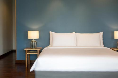 A bed or beds in a room at Mantra Samui Resort - SHA Plus