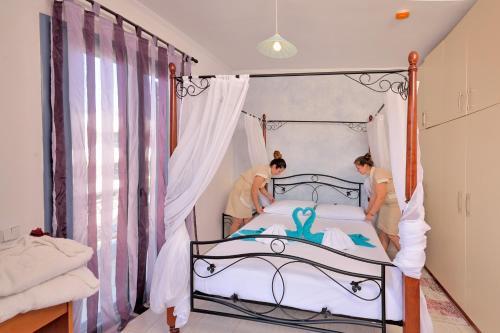 Säng eller sängar i ett rum på 12 Islands Villas