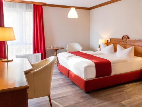 A bed or beds in a room at DORMERO Hotel Plauen
