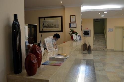 The lobby or reception area at Hotel Apolo