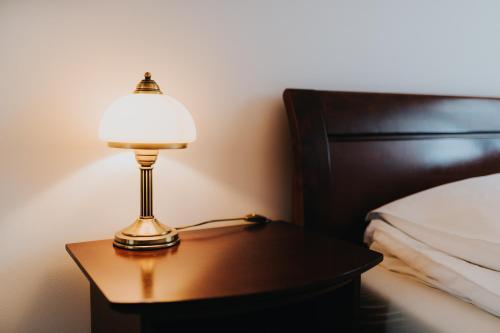 Łóżko lub łóżka w pokoju w obiekcie Elite Apartments by the Seaside Jelitkowski Dwór