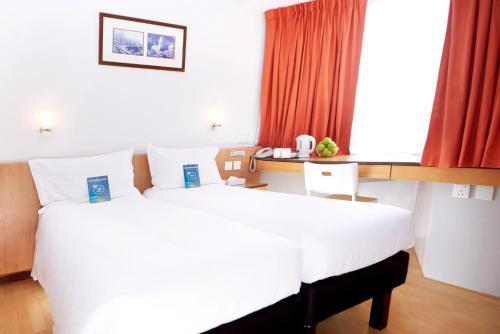 Кровать или кровати в номере ibis Hong Kong North Point