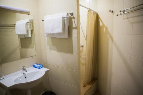 Ванная комната в Kosmos, cozy mini-hotel