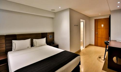 A bed or beds in a room at Palais Hotel