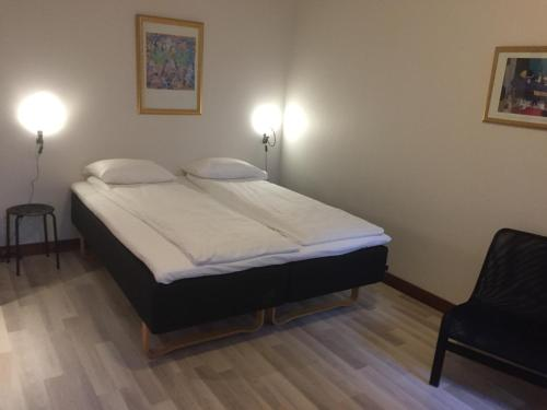 A bed or beds in a room at P-Hotels Oslo