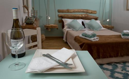 A bed or beds in a room at Athens Wooden Studio