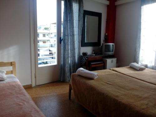 A bed or beds in a room at Pasiphae Heraklion Hotel