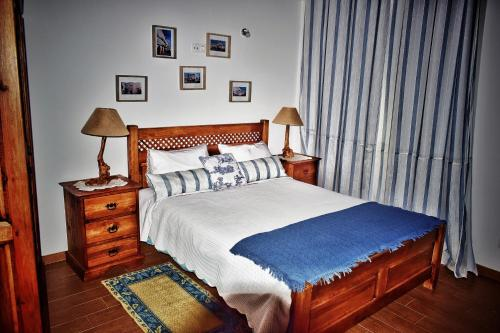 A bed or beds in a room at Bella's House
