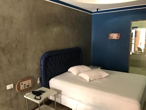 Cama ou camas em um quarto em Cassino Motel