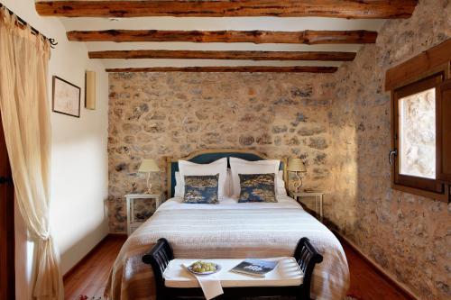 Cama o camas de una habitación en Hotel Mas de la Serra