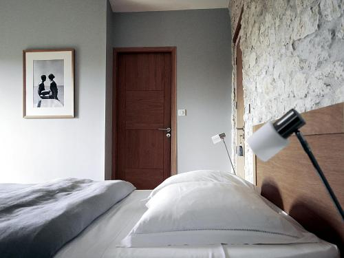 A bed or beds in a room at La Bastide