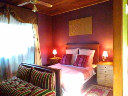 Cama ou camas em um quarto em Solar Arc en ciel