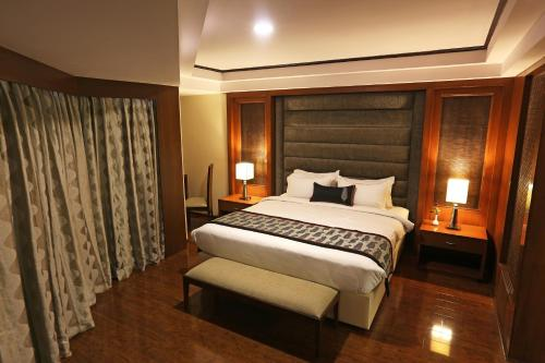 A bed or beds in a room at Golden Tulip Jaipur
