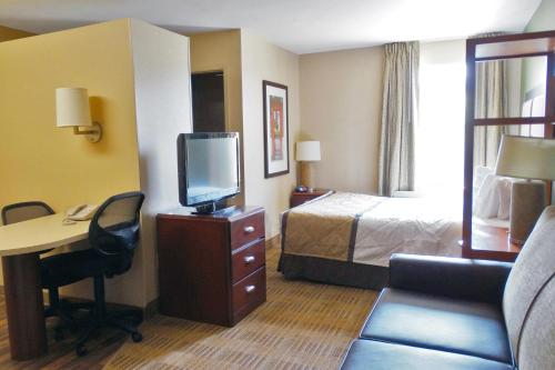 A television and/or entertainment center at Extended Stay America Suites - Dallas - Vantage Point Dr