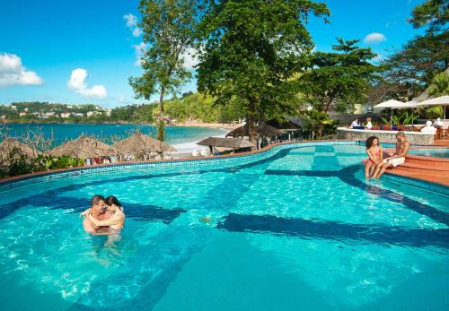 The swimming pool at or near Sandals Regency La Toc All Inclusive Golf Resort and Spa - Couples Only