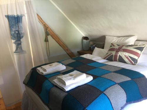 A bed or beds in a room at All Seasons Bed & Breakfast