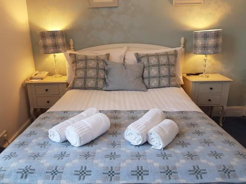 A bed or beds in a room at Gwesty'r Marine Hotel & Spa